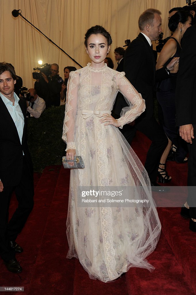 Lily Collins attends the 'Schiaparelli And Prada: Impossible Conversations' Costume Institute Gala at the Metropolitan Museum of Art on May 7, 2012 in New York City.