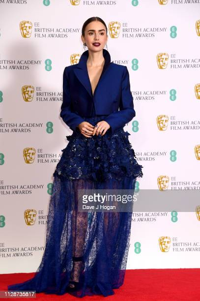 Lily Collins in the press room during the EE British Academy Film Awards at Royal Albert Hall on February 10 2019 in London England