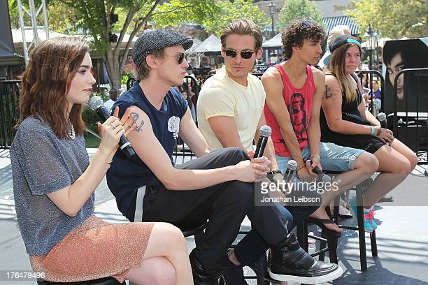 Lily Collins Jamie Campbell Bower Kevin Zegers and Robert Sheehan attend the 'The Mortal Instruments City Of Bones' meet and greet at The Americana...