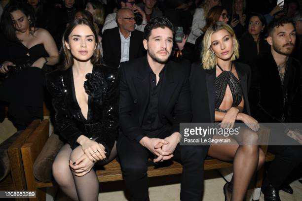 Lily Collins, Kit Harington and Hailey Baldwin attend the Saint Laurent show as part of the Paris Fashion Week Womenswear Fall/Winter 2020/2021 on...