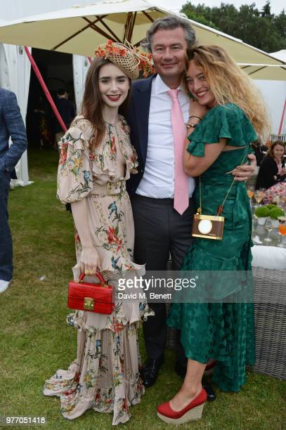 Lily Collins Laurent Feniou and Alice Temperley attend the Cartier Queen's Cup Polo Final at Guards Polo Club on June 17 2018 in Egham England