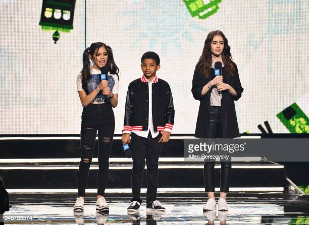 Lily Collins Lonnie Chavis and Jenna Ortega speak onstage at WE Day California at The Forum on April 19 2018 in Inglewood California