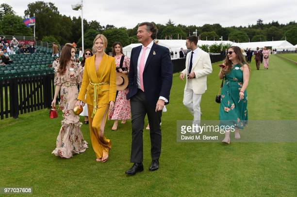 Lily Collins Martha Hunt and Laurent Feniou attend the Cartier Queen's Cup Polo at Guards Polo Club on June 17 2018 in Egham England