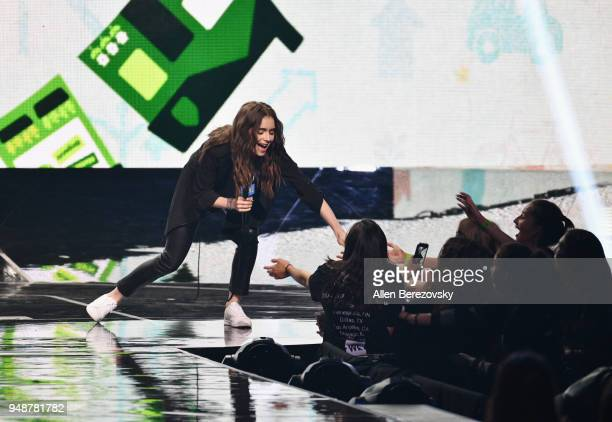 Lily Collins onstage at WE Day California at The Forum on April 19 2018 in Inglewood California