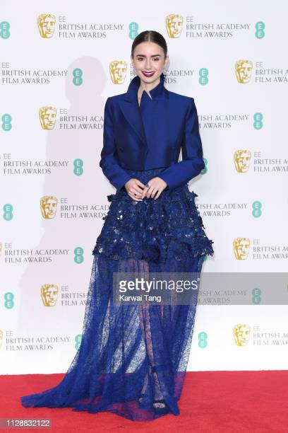 Lily Collins poses in the press room during the EE British Academy Film Awards at Royal Albert Hall on February 10 2019 in London England