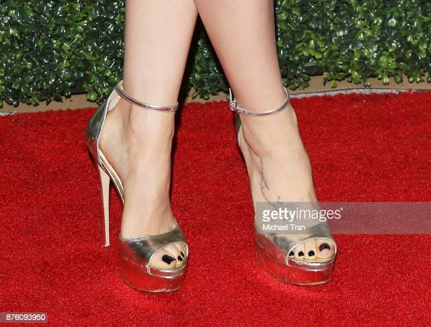 Lily Collins tattoo nail polish and shoe detail arrives to the 2017 GO Campaign Gala held at NeueHouse Los Angeles on November 18 2017 in Hollywood...