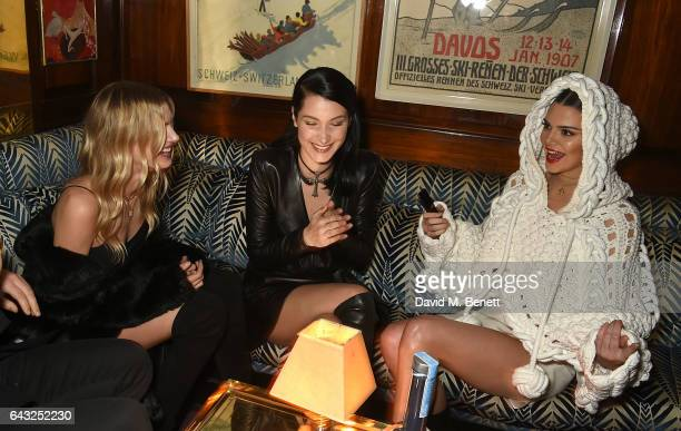 Lily Donaldson Bella Hadid and Kendall Jenner wearing Burberry Feb 2017 Couture cape at the LOVE and Burberry London Fashion Week Party at Annabel's...