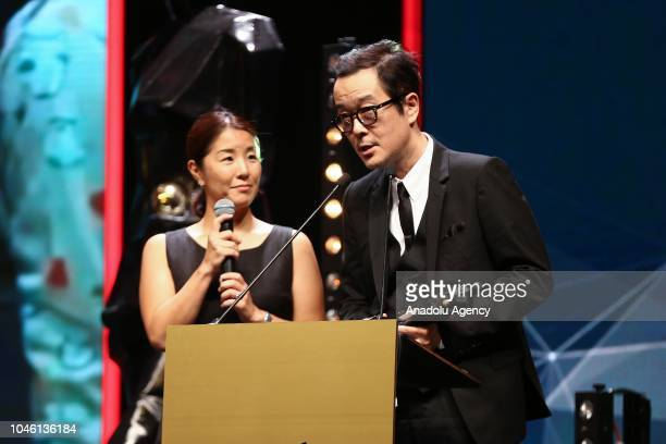 Lily Franky makes a speech after receiving the Best Director award on behalf of director Hirokazu Koreeda for the movie Shoplifters during the...