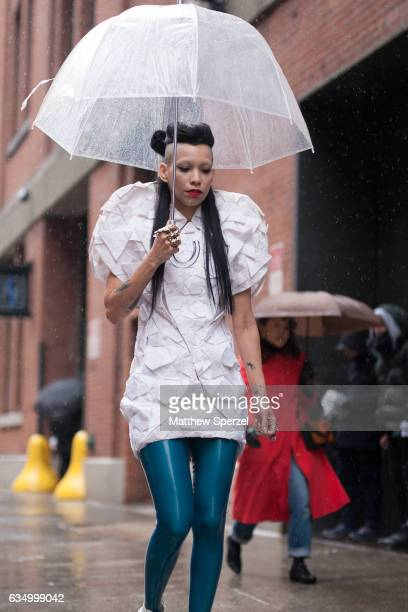 Lily Gatins is seen attending Public School during New York Fashion Week wearing a white avant garde dress with turquoise latex pants on February 12...