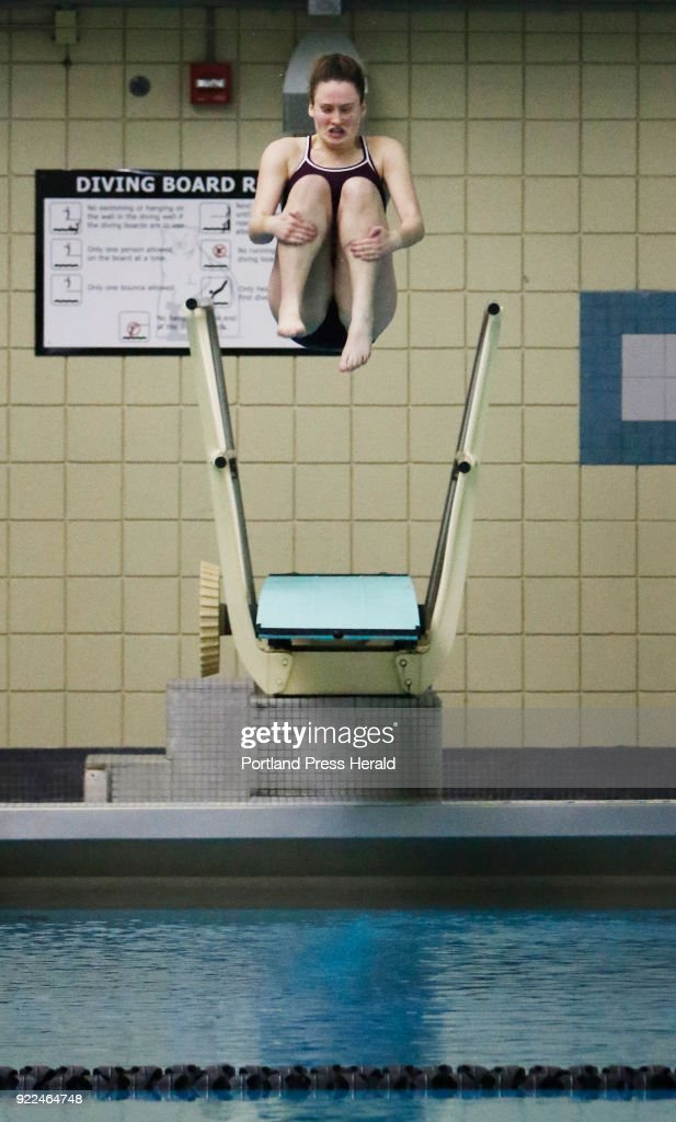 Lily Hayden-Hunt of Greely competes in the diving portion of the Class B girls swimming championships at Bowdoin College.