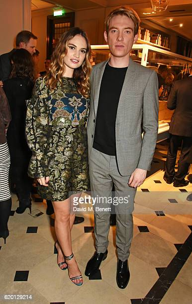 Lily James and Domhnall Gleeson wearing Burberry attend an event to celebrate 'The Tale of Thomas Burberry' at Burberry's all day cafe Thomas's on...
