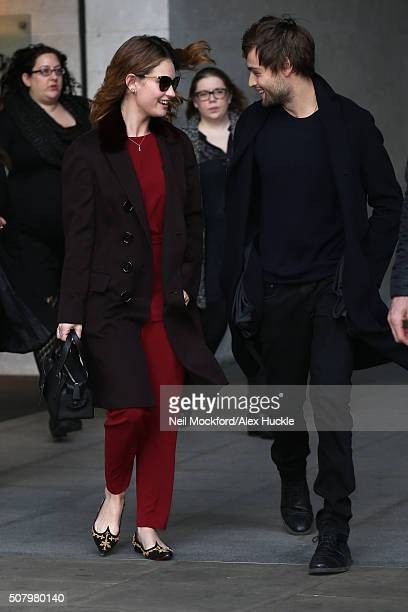 Lily James and Douglas Booth seen at BBC Radio One promoting 'Pride and Prejudice and Zombies' on February 2 2016 in London England