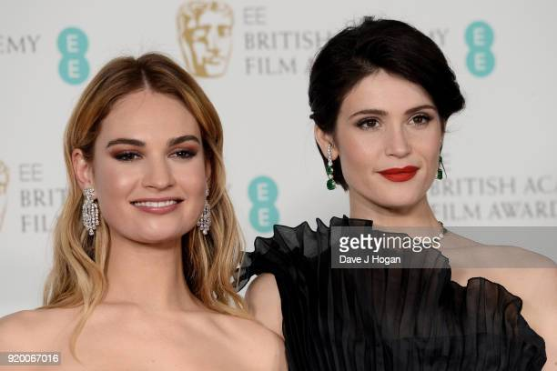 Lily James and Gemma Arterton pose in the press room during the EE British Academy Film Awards held at Royal Albert Hall on February 18 2018 in...