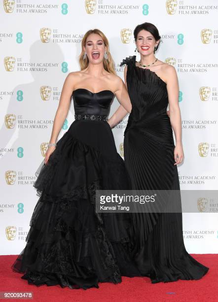 Lily James and Gemma Arterton pose in the press room during the EE British Academy Film Awards held at the Royal Albert Hall on February 18 2018 in...