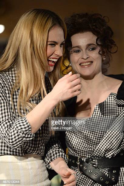 Lily James and Helena Bonham Carter pose during the Cinderella Exhibition Launch Photocall at Leicester Square on March 20 2015 in London England