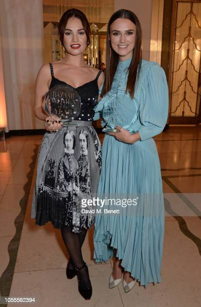 Lily James and Keira Knightley attend the Harper's Bazaar Women Of The Year Awards 2018 in partnership with Michael Kors and MercedesBenz at...