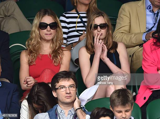 Lily James and Laura Carmichael attend the mens singles final between Novak Djokovic and Roger Federer on centre court during day thirteen of the...