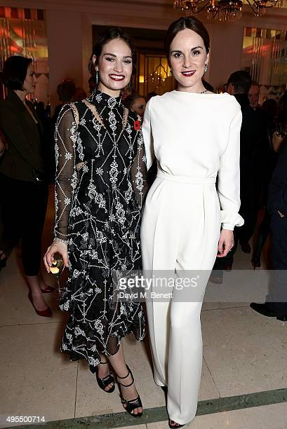 Lily James and Michelle Dockery attend the Harper's Bazaar Women of the Year Awards 2015 at Claridges Hotel on November 3 2015 in London England