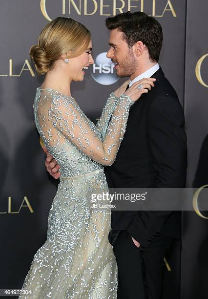 Lily James and Richard Madden attend the premiere of Disney's 'Cinderella' at the El Capitan Theatre on March 1 2015 in Hollywood California