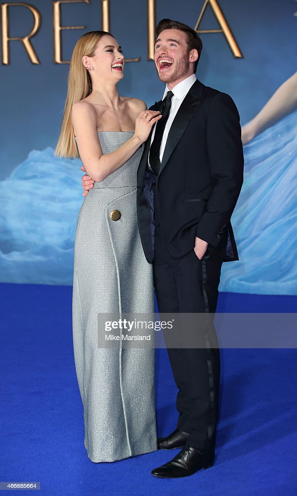 Lily James and Richard Madden attend the UK Premiere of 'Cinderella' at Odeon Leicester Square on March 19, 2015 in London, England.
