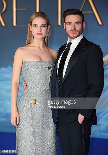 """Lily James and Richard Madden attend the UK Premiere of """"Cinderella"""" at Odeon Leicester Square on March 19, 2015 in London, England."""