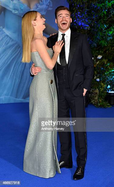 Lily James and Richard Madden attend the UK Premiere of 'Cinderella' at Odeon Leicester Square on March 19 2015 in London England