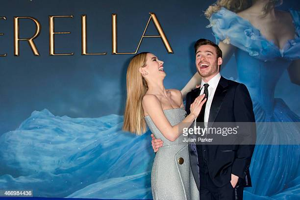 Lily James and Richard Madden attends the UK Premiere of Cinderella at Odeon Leicester Square on March 19 2015 in London England