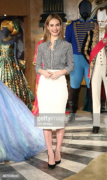 Lily James attends a photocall for the Cinderella Exhibition at Leicester Square on March 20 2015 in London England