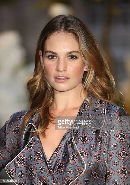 Lily James attends the Burberry show during London Fashion Week Spring/Summer collections 2016/2017 on September 19 2016 in London United Kingdom