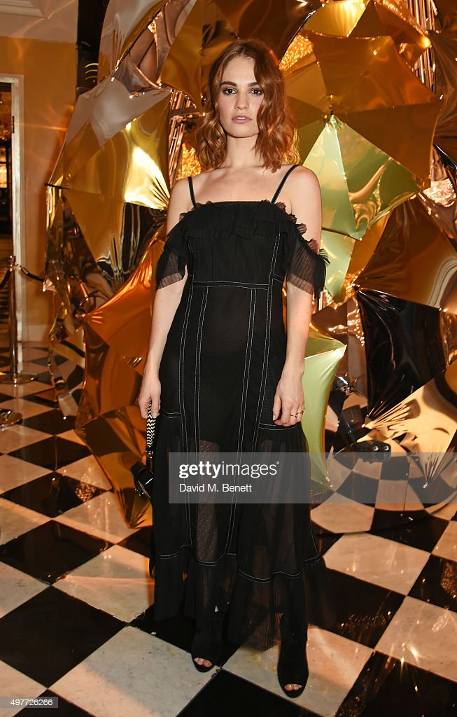 Lily James attends the Claridge's Christmas Tree Party 2015, designed by Christopher Bailey for Burberry, at Claridge's Hotel on November 18, 2015 in London, England.