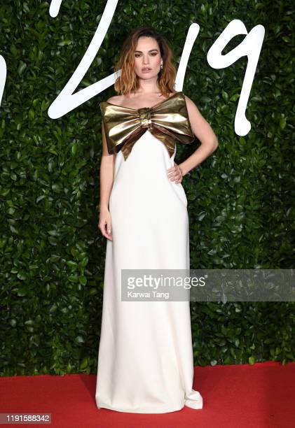 Lily James attends The Fashion Awards 2019 at the Royal Albert Hall on December 02 2019 in London England