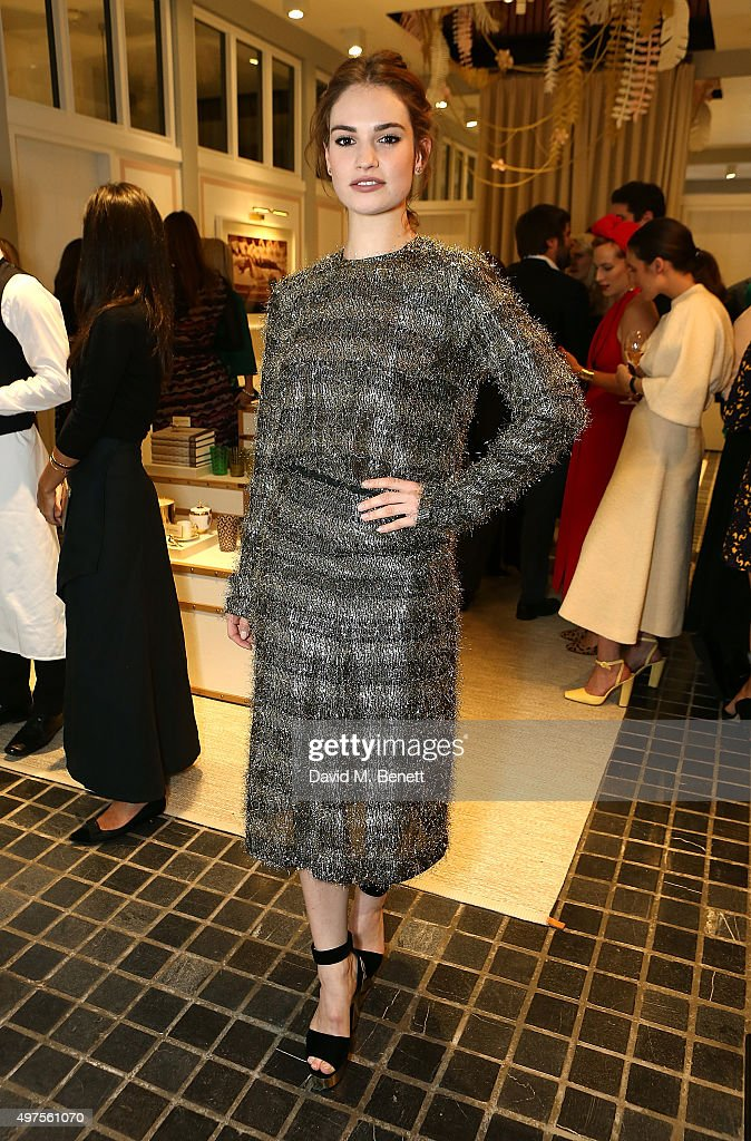Lily James attends the Moda Operandi Holiday dinner hosted by Lauren Santo Domingo on November 17, 2015 in London, England.