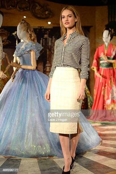 Lily James during the Cinderella Exhibition Launch Photocall at Leicester Square on March 20 2015 in London England