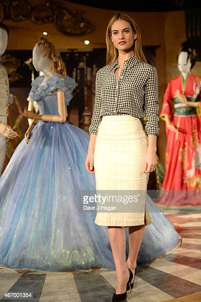 Lily James poses during the Cinderella Exhibition Launch Photocall at Leicester Square on March 20 2015 in London England