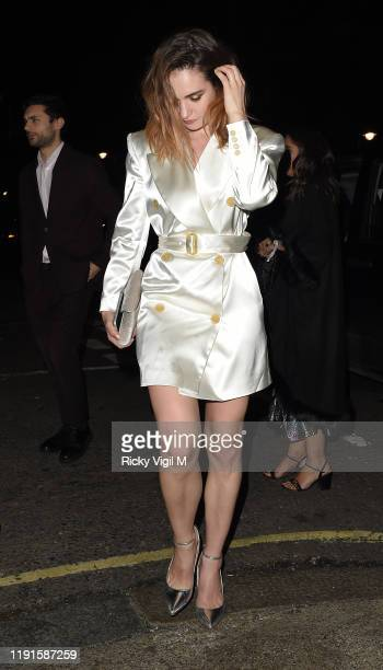 Lily James seen attending Giorgio Armani Fashion Awards afterparty at Harry's Bar on December 02 2019 in London England