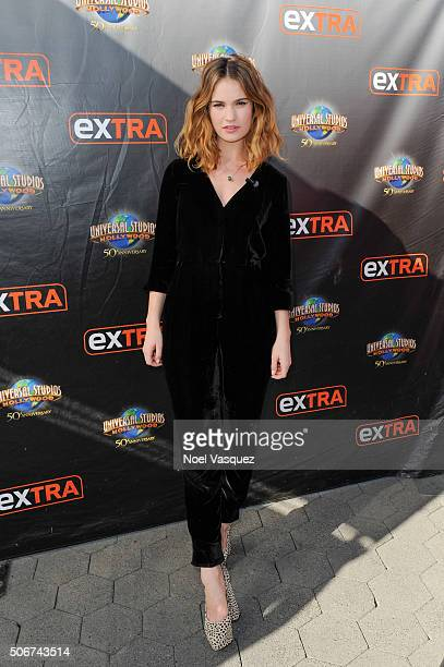 Lily James visits 'Extra' at Universal Studios Hollywood on January 25 2016 in Universal City California