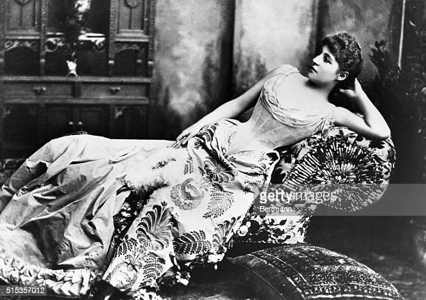 Lily Langtry the English beauty and actress reclining on a sofa