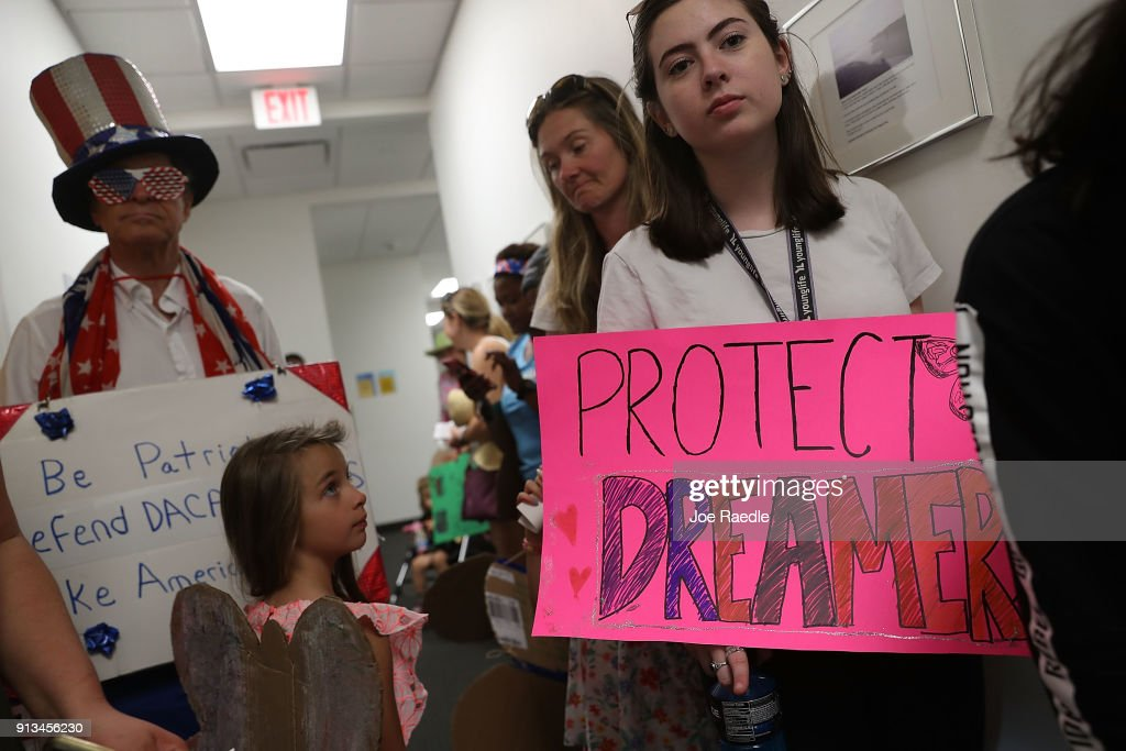 Lily Logsdon (R) joins with other activists in front of the office of Sen. Bill Nelson (D-FL) to ask him to help recipients of the Deferred Action for Childhood Arrivals (DACA) as well as all immigrants living in America on February 2, 2018 in West Palm Beach, Florida. The events organizers expressed their concerns about the current political landscape and how they feel it is contributing to the persecution and discrimination of documented and undocumented immigrants.