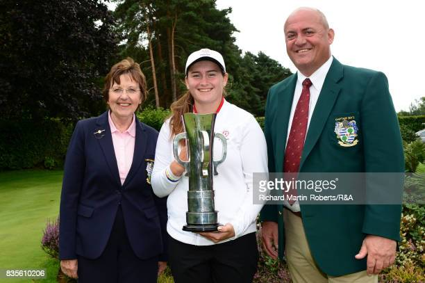 Lily May Humphreys of England poses with the trophy and the Enville Golf Club Captains following her victory during the final of the Girls' British...