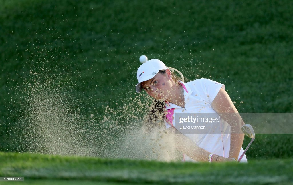 Lily May Humphreys of the Great Britain and Irlenad Team plays her second shot on teh 13th hole in her match with Paula Grant against Lauren Stephenson and Kristen Gillman of the United States team during the afternoon foursomes matches in the 2018 Curtis Cup Match at Quaker Ridge Golf Club on June 8, 2018 in Scarsdale, New York.