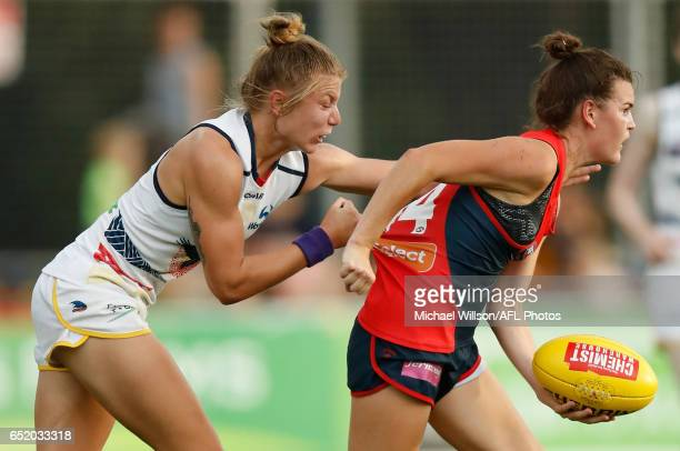 Lily Mithen of the Demons is tackled by Kellie Gibson of the Crows during the 2017 AFLW Round 06 match between the Adelaide Crows and the Melbourne...