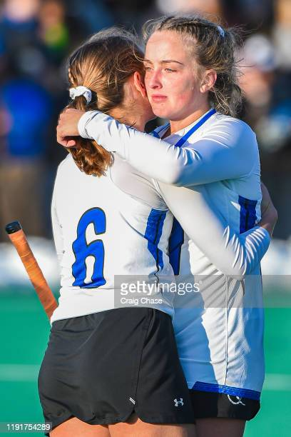 Lily Mynott of Franklin Marshall consoles teammate Ellie Paige following the Division III Women's Field Hockey Championship held at Spooky Nook...