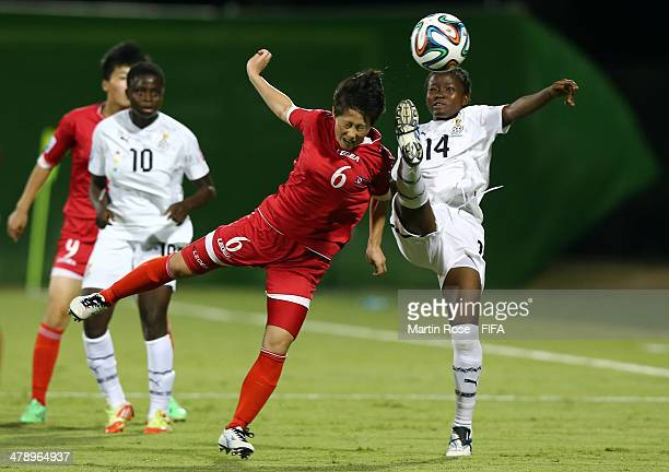 Lily Niber Lawrence of Ghana and Ri Kum Hyang of Korea DPR battle for the ball during the FIFA U17 Women's World Cup 2014 group B match between Ghana...