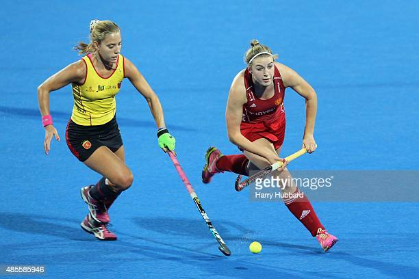 Lily Owsley of England and Cristina Guinea of Spain in action during the match between England and Spain on day eight of the Unibet EuroHockey...