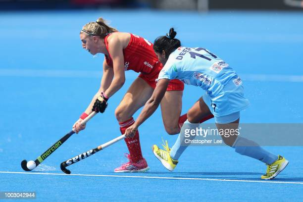Lily Owsley of England battles with Deepika of India during the Pool B game between England andIndia of the FIH Womens Hockey World Cup at Lee Valley...