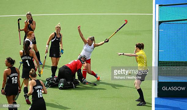 Lily Owsley of England celebrates scoring the opening goal during the Women's Hockey Semi Final between New Zealand and England at Glasgow National...
