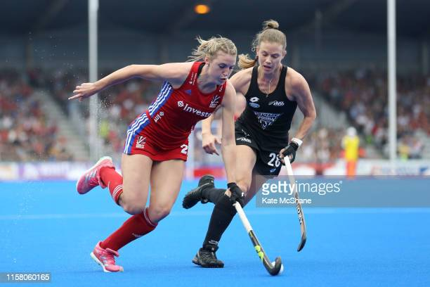 Lily Owsley of Great Britain and Shiloh Gloyn of New Zealand battle for the ball during the Women's FIH Field Hockey Pro League match between Great...