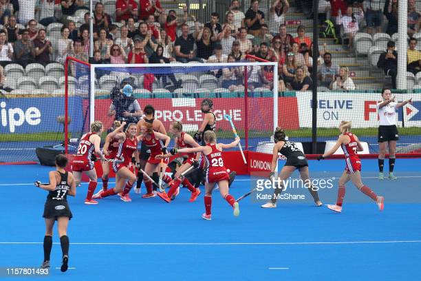 Lily Owsley of Great Britain celebrates scoring her side's second goal with team mates during the Women's FIH Field Hockey Pro League match between...