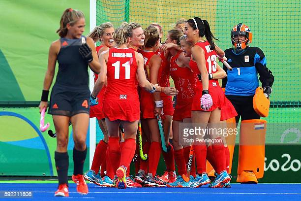 Lily Owsley of Great Britain celebrates with teammates after scoring a goal against Netherlands during the Women's Gold Medal Match on Day 14 of the...