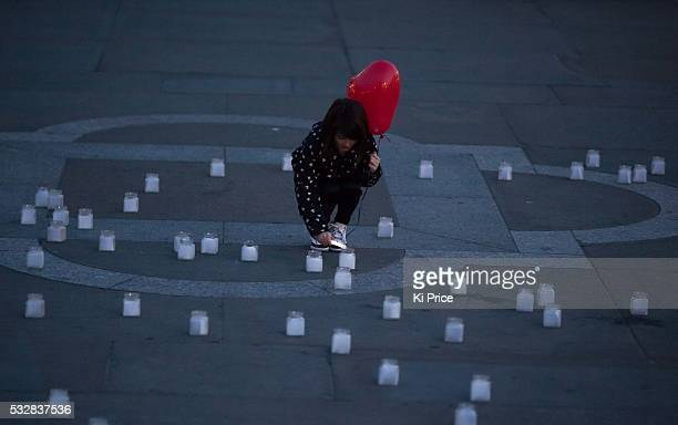Lily Rose Aslandogdu ten the star of Save the Children's viral Second a Day video lights the #withsyria vigil in Trafalgar square to mark the 3rd...